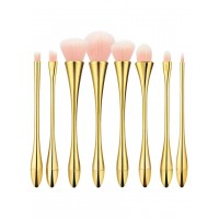 Makeup brushes set with pink bristles, gold handle and cap